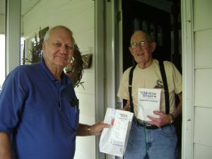 2 old men receiving their pharmacy delivered drugs from Harrisburg hospital pharmacy